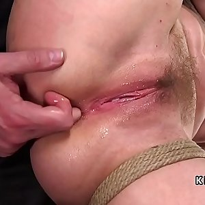 Busty babe in bondage ass fucking fingered